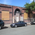 The building has been fenced and prepared for demolition.
